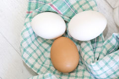Group of three eggs on colored cloth Stock Image
