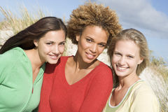 Group of three female friends at beach. Group of three female friends outdoors at beach royalty free stock photo