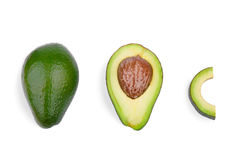 A group of three fresh avocados, isolated on a white background. Organic vegetables. Healthful lifestyle. Royalty Free Stock Image