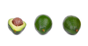 A group of three fresh avocados with a scratchy texture, isolated on a white background. Healthful lifestyle. Stock Photography
