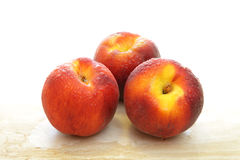 Group of three fresh peaches Royalty Free Stock Photography