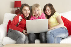 Group Of Three Girls Using Laptop At Home stock photography