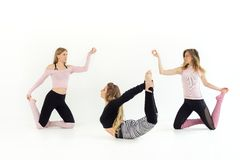 Three young beautiful girls are dancing. yoga and pilates are practiced royalty free stock photos