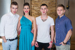Group of three guys musician and a girl singer royalty free stock photography