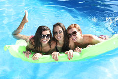 Group of three happy and beautiful young girl friends having bat Stock Photos