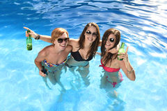 Group of three happy girl friends having bath in swimming pool t Royalty Free Stock Photos