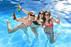 Group of three happy girl friends having bath in swimming pool t Royalty Free Stock Photography