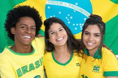 Group of three laughing brazilian soccer fans stock photos
