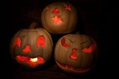 Group of three lit white jack o'lanterns royalty free stock photography