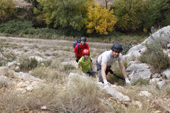 Group of three mountaineers doing a via ferrata. In Spain Royalty Free Stock Image