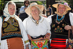 Group of three old Romanian women dressed in folk costumes Stock Photos