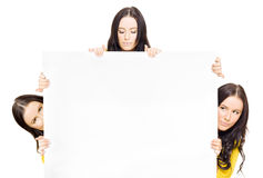 Group Of Three People Holding Big Blank Billboard. Studio Image Of A Group Of Three People Displaying A Big Blank Billboard With Space For Add Info In A Stock Photography