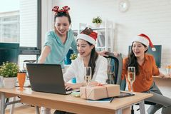 Group of three people surfing on the net. To check online Christmas sale shopping and found some interesting stuff online Stock Photography