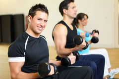 Group of three people training with dumbbells Stock Image