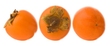 Group of three persimmon fruits Stock Images