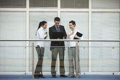 Group of three persons talking office stock photos