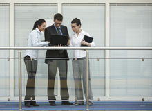 Group of three persons talking office Stock Photo