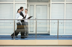 Group of three persons talking office stock images