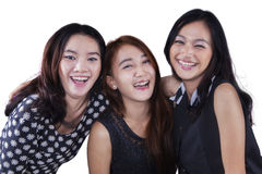Group of three pretty teenage girls Stock Photo