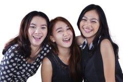 Group of three pretty teenage girls Stock Photo