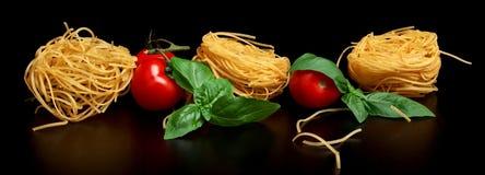 Group of three round balls of raw pasta on black Royalty Free Stock Photo