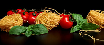 Group of three round balls of raw pasta on black Stock Image