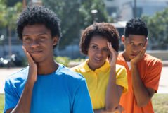 Group of three sad african american young adults Stock Photos