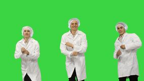 Group of three smiling doctors on a Green Screen, Chroma Key.