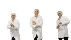 Group of three smiling doctors on white background.