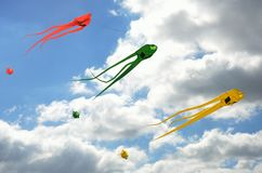 Group of three space invader kites. Flying horizontally Royalty Free Stock Photo