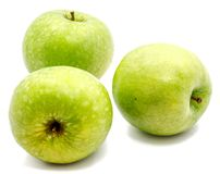 Apple Granny Smith. Group of three whole green apples Granny Smith isolated on white background n Stock Photo