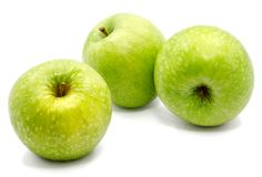Apple Granny Smith. Group of three whole green apples Granny Smith isolated on white background n Royalty Free Stock Photos