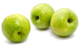 Apple Granny Smith. Group of three whole green apples Granny Smith isolated on white background n Stock Image