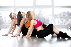 Group of three women have fitness practice in class Royalty Free Stock Images