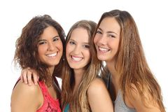 Group of three women laughing and looking at camera. Isolated on a white background stock photo