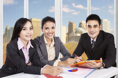 Group of three workers meeting in office Royalty Free Stock Photography