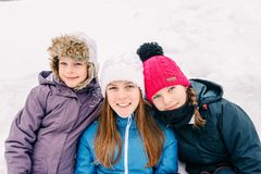 Group of three young girl friends outdoors in winter royalty free stock photos