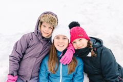 Group of three young girl friends outdoors in winter stock photo