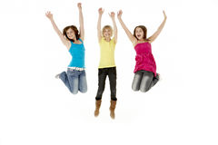 Group Of Three Young Girls Leaping In Air Stock Photo