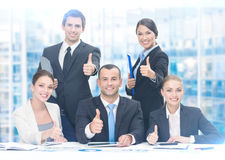 Group of thumbing up managers royalty free stock images