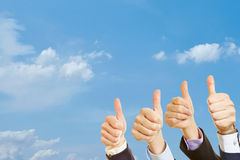 Group with thumbs up in the air Stock Photo