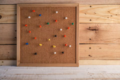 Group of thumbtacks pinned on corkboard Stock Images