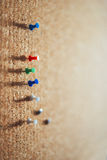 Group of thumbtacks pinned on corkboard. Texture background Royalty Free Stock Photography