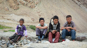 Group of Tibetan chidren sitting together. Leh, India - Jul 22, 2015. Group of Tibetan chidren sitting together on the road to Nubra Valley, India. 65% of Royalty Free Stock Photo