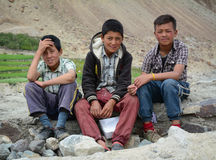 Group of Tibetan chidren sitting together. Leh, India - Jul 22, 2015. Group of Tibetan chidren sitting together on the road to Nubra Valley, India. 65% of Stock Photo