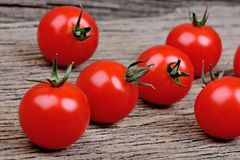 Group of tomatoes cherry on rustic wooden table Stock Image