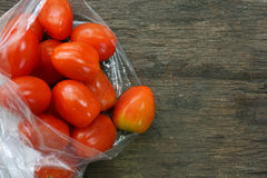 Group of tomatoes in plastic bag Royalty Free Stock Photo