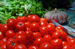 Group of tomatoes in rural kitchen Stock Images