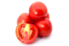 Group of tomatos with slice Stock Image