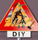 Group of tools spread on a traffic sign with DIY m Royalty Free Stock Image